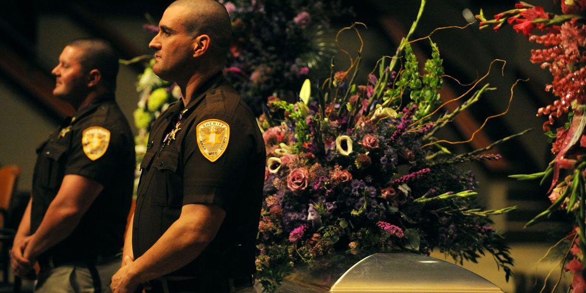 Officers stand watch over casket of fallen officer's daughter