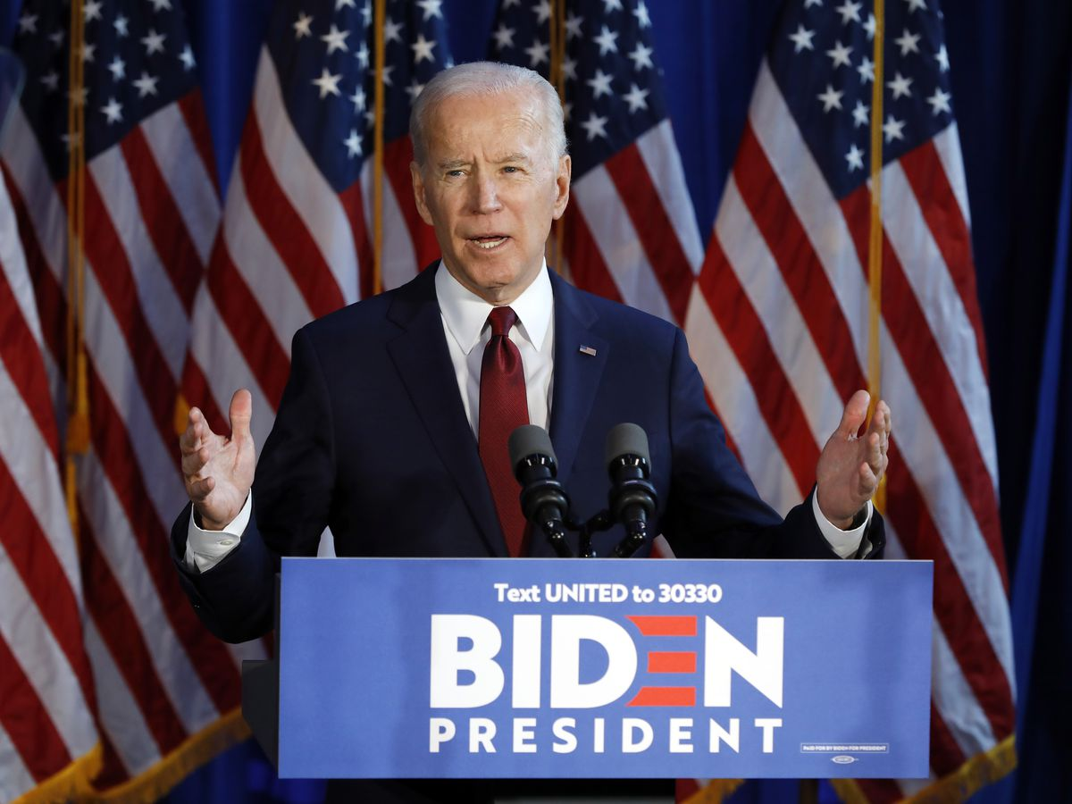 Biden aims to move left without abandoning centrist roots
